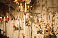 """Switzerland. Canton Tessin. Vira Gambarogno. The old town shows an exhibit of various Nativity scenes, illuminated at night for the Christmas holiday season. A Nativity Scene, may be used to describe any depiction of the Nativity of Jesus in art, but in the sense covered here, also called a crib or in North America and France a crèche (meaning """"crib"""" or """"manger"""" in French). It means a three-dimensional folk art depiction of the birth or birthplace of Jesus, either sculpted or using two-dimensional (cut-out) figures arranged in a three-dimensional setting. Christian nativity scenes, in two dimensions (drawings, paintings, icons, etc.) or three (sculpture or other three-dimensional crafts), usually show Jesus in a manger, Joseph and Mary in a barn (or cave). Corks wine. © 2007 Didier Ruef"""