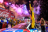 #18: Kyle Busch, Joe Gibbs Racing, Toyota Camry M&M's Red White & Blue, celebrates in victory lane after winning in Charlotte.