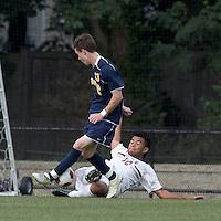 Boston College defender/forward Kevin Mejia (12) slide tackle on Quinnipiac University midfielder Tim Quigley (13). Boston College defeated Quinnipiac, 5-0, at Newton Soccer Field, September 1, 2011.