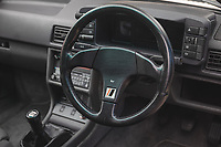 BNPS.co.uk (01202) 558833. <br /> Pic: SilverstoneAuctions/BNPS<br /> <br /> Pictured: Quattro badge on the steering wheel. <br /> <br /> Fire up the price tag...<br /> <br /> This immaculate Audi Quattro got collectors of 'modern classic' cars all fired up - as it sold for a record-breaking price of £163,125.<br /> <br /> The iconic eighties motor was believed to be the last one ever manufactured by the German car giant when it rolled off the production line in 1991.<br /> <br /> The UR Quattro 20V has had just two owners in its 30 year life and has just 9,700 miles on the clock.<br /> <br /> As a result the pearly white vehicle proved highly desirable when it went under the hammer.