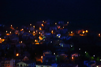 Here, an artistic, colorful view from the top oh the upland where is located the historical center of Lugnano in Teverina to the new part of the little town, on the bases of the near mountain. The photo is taken in the night, and the fact that it is blurry gives back a nice game of lights, made by the street-lamps.<br /> <br /> You can download this file for (E&PU) only, but you can find in the collection the same one available instead for (Adv).