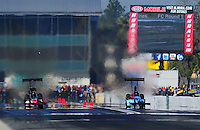 Mar. 13, 2011; Gainesville, FL, USA; NHRA top fuel dragster driver Doug Foley (right) defeats Doug Kalitta during the Gatornationals at Gainesville Raceway. Mandatory Credit: Mark J. Rebilas-