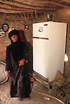 Marsh Arabs. Southern Iraq.  Marsh Arab woman in her adobe home with new refrigerator. 1984