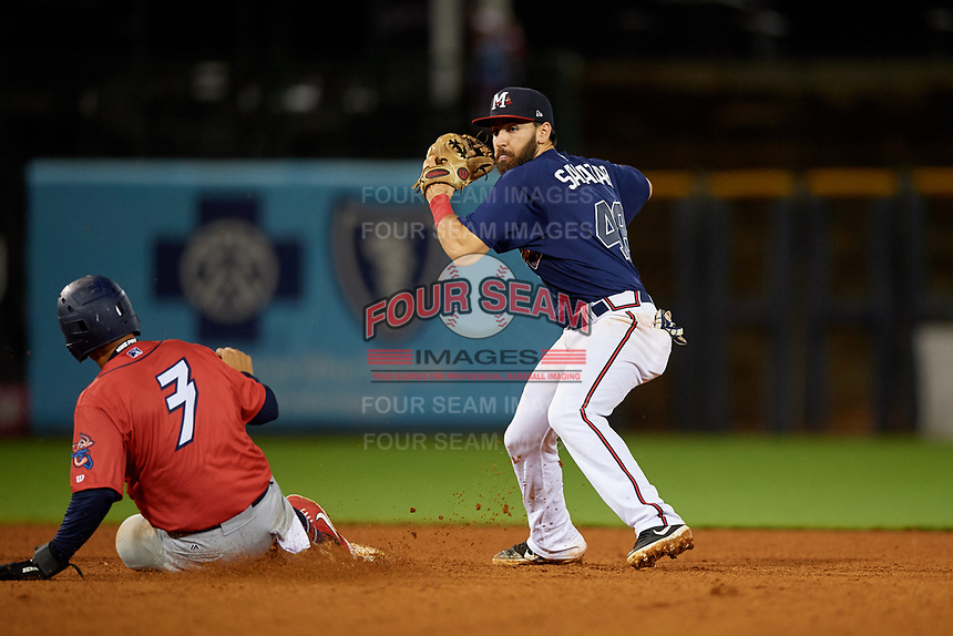 Mississippi Braves second baseman Alejandro Salazar (48) turns a double play as Joe Dunand (3) slides in during a Southern League game against the Jacksonville Jumbo Shrimp on May 4, 2019 at Trustmark Park in Pearl, Mississippi.  Mississippi defeated Jacksonville 2-0.  (Mike Janes/Four Seam Images)