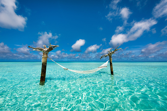 A relaxing escape... this hammock stands on a small sandbar in the lagoon waters of the Indian Ocean.<br /> Artist Edition: 15/100 Limited