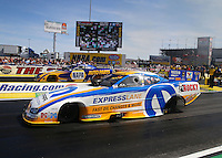 Mar 28, 2014; Las Vegas, NV, USA; NHRA funny car driver Matt Hagan (near lane) races alongside Ron Capps during qualifying for the Summitracing.com Nationals at The Strip at Las Vegas Motor Speedway. Mandatory Credit: Mark J. Rebilas-