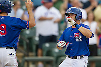 Round Rock Express catcher JP Arencibia (10) is greeted at home by teammate Adam Rosales (9) after slugging a home run during the Pacific Coast League baseball game against the Sacramento River Cats on June 19, 2014 at the Dell Diamond in Round Rock, Texas. The Express defeated the River Cats 7-1. (Andrew Woolley/Four Seam Images)