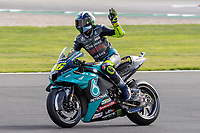 28th August 2021; Silverstone Circuit, Silverstone, Northamptonshire, England; MotoGP British Grand Prix, Qualifying Day; Petronas Yamaha SRT rider Franco Valentino Rossi on his Yamaha YZR-M1 waves to the fans