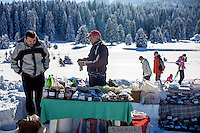 Former refugee Elvis Causevic (left) with his father Nedzib who collects and sells herbal teas (Planinski Caj - Mountain Tea) and tonics from a stall on the Igman plateau, one of the venues for the 1984 Winter Olympics. <br /> <br /> In 1992 while volunteering at the Varazdin refugee camp Panos photographer Bjoern Steinz met and became close to Elvis, a Bosnian Muslim refugee, and his family. They shared the hardships of camp life together which Steinz documented. While the prints were archived for many years two of the images always returned to Bjoern's thoughts. 25 years later he set out to try and find out what had happened to Elvis and his family in the intervening years. Modern social media made the task surprisingly easy and they were reunited in Hadzici where Elvis now lives with his family.