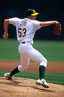 OAKLAND, CA - Barry Zito of the Oakland Athletics pitches during a game against the Toronto Blue Jays at the Oakland Coliseum in Oakland, California on August 1, 2000. Photo by Brad Mangin