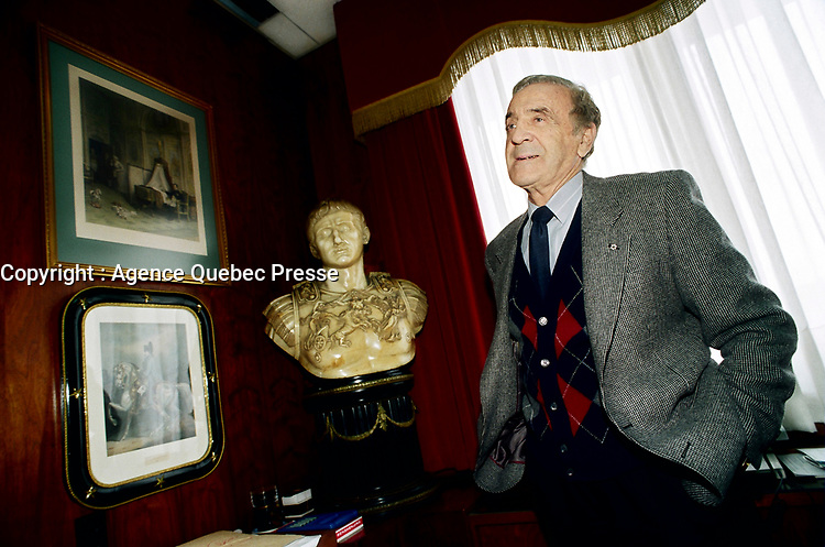 """Montreal (Qc) CANADA -<br /> -File Photo - circa 1998<br /> <br /> EXCLUSIVE PHOTO of Benjamin """"Ben"""" Weider in his office.<br /> <br /> Benjamin """"Ben"""" Weider (born February 1, 1924 in Montreal, Quebec, Canada) is the co-founder of the International Federation of BodyBuilders (IFBB) along with brother Joe Weider. He is a Jewish businessman from Montreal well-known in two areas: Bodybuilding and Napoleonic history.<br /> <br /> Weider is known as a forceful advocate of the theory that Napoleon was assassinated by a member of his entourage during his exile in Saint Helena. He co-authored a book, The Murder Of Napoleon, with Sten Forshufvud about this. Weider also founded the International Napoleonic Society, of which he is the President, and has written numerous articles for this organization.[1]"""