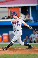Joseph Bonfe #34 of the Kingsport Mets follows through on his swing versus the Burlington Royals at Burlington Athletic Park July 3, 2009 in Burlington, North Carolina. (Photo by Brian Westerholt / Four Seam Images)