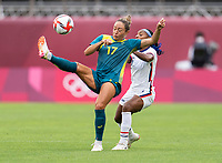 KASHIMA, JAPAN - JULY 27: Kyah Simon #17 of Australia clears the ball away from Crystal Dunn #2 of the USWNT during a game between Australia and USWNT at Ibaraki Kashima Stadium on July 27, 2021 in Kashima, Japan.