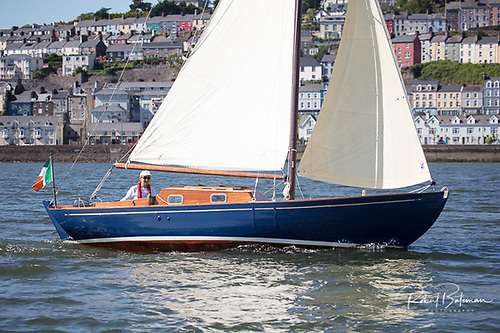 Happy man – Pat Murphy at the helm of Pinkeen off Cobh.  Photo: Bob Bateman