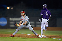 St. John's Red Storm first baseman David Williams (16) waits for the throw as Will Prater (5) of the Western Carolina Catamounts hustles down the line at Childress Field on March 12, 2021 in Cullowhee, North Carolina. (Brian Westerholt/Four Seam Images)