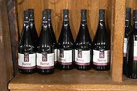 Bottles of Kum Blatina on a shelf in the wine shop. Hercegovina Produkt winery, Citluk, near Mostar. Federation Bosne i Hercegovine. Bosnia Herzegovina, Europe.