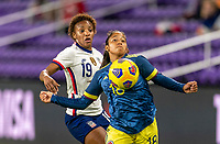 ORLANDO, FL - JANUARY 18: Crystal Dunn #19 of the USWNT defends Manuela Pavi #18 of Colombia during a game between Colombia and USWNT at Exploria Stadium on January 18, 2021 in Orlando, Florida.