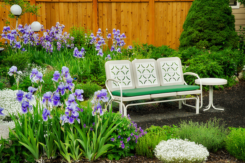 Garden with benches and chairs at the Bronze Antler bed and breakfast. Joseph, Oregon