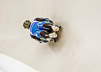4 December 2015: Oleksandr Obolonchyk and Roman Zakharkiv, sliders from Ukraine, bank into a turn on their first run of the Doubles Competition during the Viessmann Luge World Cup Series at the Olympic Sports Track in Lake Placid, New York, USA. Mandatory Credit: Ed Wolfstein Photo *** RAW (NEF) Image File Available ***