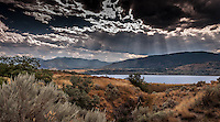 Fine Art Landscape Photograph, Sunbeams and Sagebrush, mountain view of the  Okanagan Lake with dramatic sunbeams shining down on the valley.