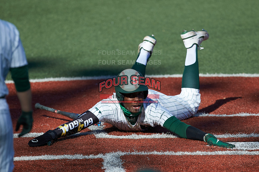 Gino Groover (23) of the Charlotte 49ers sides head first across home plate against the Florida Atlantic Owls at Hayes Stadium on April 2, 2021 in Charlotte, North Carolina. The 49ers defeated the Owls 9-5. (Brian Westerholt/Four Seam Images)