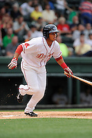 Third baseman Aneudis Peralta (28) of the Greenville Drive in a game against the Charleston RiverDogs on Wednesday, June 11, 2014, at Fluor Field at the West End in Greenville, South Carolina.  Greenville won, 6-3. (Tom Priddy/Four Seam Images)