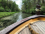 The General Harrison canal boat makes its way down a restored section of the Miami & Erie Canal at the John Johnston Farm & Indian Agency in Piqua, Ohio.