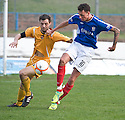 DUMBARTON'S PAUL NUGENT AND COWDENBEATH'S LIAM COULT CHALLENGE FOR THE BALL