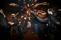 A protester takes a picture with his mobile phone as fireworks explode above police. Pro-Palestinian protesters clashed with police as they held another demonstration against Israel in the Norwegian capital Oslo. Violent clashes lasted for hours  in the centre of Oslo. Israeli forces began a series of air strikes on the Gaza Strip on the 27th of December in retaliation against Hamas rockets fired into Israel. After eight days of bombardment, leaving over 400 Palestinians and four Israelis dead, Israeli tanks launched a ground invasion on the 4th of January.