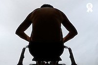 Mature man training on rowing machine, rear view, close-up (Licence this image exclusively with Getty: http://www.gettyimages.com/detail/200503010-002 )