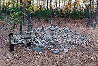 Visitor rock pile and cairns pay tribute on the site of Thoreau's cabin at Walden Pond, Concord, Massachusetts, USA
