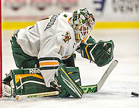 29 December 2014: University of Vermont Catamount Goaltender Mike Santaguida, a Sophomore from Mississauga, Ontario, makes a first period save against the Providence College Friars in the deciding game of the annual TD Bank-Sheraton Catamount Cup Tournament at Gutterson Fieldhouse in Burlington, Vermont. The Friars shut out the Catamounts 3-0 to win the 2014 Cup. Mandatory Credit: Ed Wolfstein Photo *** RAW (NEF) Image File Available ***