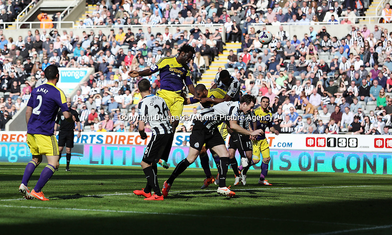 Pictured: Wilfried Bony of Swansea scoring his equaliser with a header (C). Saturday 19 April 2014<br /> Re: Barclay's Premier League, Newcastle United v Swansea City FC at St James Park, Newcastle, UK.