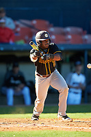 Bethune-Cookman Wildcats left fielder Rakeem Quinn (2) bunts during a game against the Wisconsin-Milwaukee Panthers on February 26, 2016 at Chain of Lakes Stadium in Winter Haven, Florida.  Wisconsin-Milwaukee defeated Bethune-Cookman 11-0.  (Mike Janes/Four Seam Images)