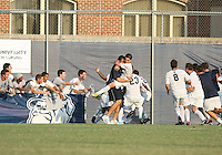 Players of Georgetown University mob Uche Oteqbeye #9 after his game winning goal during an NCAA match against Northeastern University at North Kehoe Field, Georgetown University on September 3 2010 in Washington D.C. Georgetown won 2-1 AET.