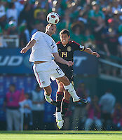 PASADENA, CA – June 25, 2011: USA player Eric Lichaj (14) and Mexico player Javier Hernandez (14) during the Gold Cup Final match between USA and Mexico at the Rose Bowl in Pasadena, California. Final score USA 2 and Mexico 4.