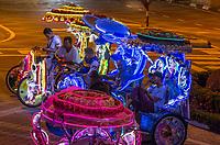Trishaw Drivers Waiting for Tourists at Night, Melaka, Malaysia.