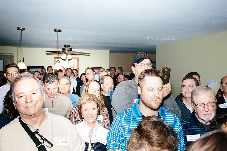 """People watch as Texas senator and Republican presidential candidate Ted Cruz speaks to attendees at an event called """"Smoke a cigar with Ted Cruz"""" at a house party at the home of Linda & Steven Goddu Salem, New Hampshire."""