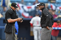 Umpires (L-R) Justin Robinson and Chris Lloyd before a game between the Asheville Tourists and the Greenville Drive on April 16, 2015 in Asheville, North Carolina. The Tourists defeated the Drive 5-4. (Tony Farlow/Four Seam Images)