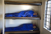 Couple of campers lying in bunk beds in a Haleakala National Park cabin