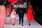 Fashion designer walks runway with models at the close of The Red Umbrella collection fashion show, at The Society Fashion Week on September 9, 2018 at The Roosevelt Hotel in New York City, during New York Fashion Week Spring Summer 2019.