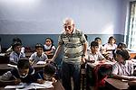 Father Laborde visits a class at Ekpranta Nagar School. West Bengal, India, Arindam Mukherjee/Agency Genesis