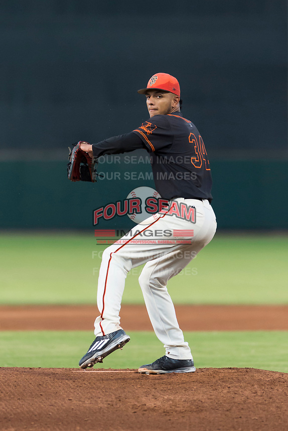 AZL Giants Black starting pitcher Israel Cruz (34) delivers a pitch during an Arizona League game against the AZL Rangers at Scottsdale Stadium on August 4, 2018 in Scottsdale, Arizona. The AZL Giants Black defeated the AZL Rangers by a score of 6-3 in the second game of a doubleheader. (Zachary Lucy/Four Seam Images)
