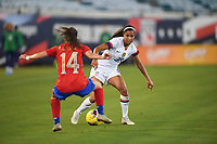 JACKSONVILLE, FL - NOVEMBER 10: Margaret Purce #30 of the United States defends against Priscilla Chinchilla #14 of Costa Rica during a game between Costa Rica and USWNT at TIAA Bank Field on November 10, 2019 in Jacksonville, Florida.