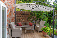 BNPS.co.uk (01202 558833)<br /> Pic: Mullucks/BNPS<br /> <br /> Pictured: Decked seating area. <br /> <br /> Time for a change...<br /> <br /> A former granary with an impressive clock tower on top is on the market for £1.45m.<br /> <br /> The new owners of the aptly-named The Clockhouse will have a tall order adjusting this timepiece when the clocks go back at the end of October.<br /> <br /> The Grade II listed property has a 10ft central wooden clock tower which is believed to date back to the construction of the original granary building in the Georgian era.