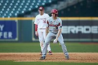 Heston Kjerstad (18) of the Arkansas Razorbacks takes his lead off of first base against the Oklahoma Sooners in game two of the 2020 Shriners Hospitals for Children College Classic at Minute Maid Park on February 28, 2020 in Houston, Texas. The Sooners defeated the Razorbacks 6-3. (Brian Westerholt/Four Seam Images)