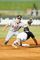 Rome Braves second baseman Ross Heffley (25) waits to apply the tag to Cleuluis Rondon (13) of the Kannapolis Intimidators as he was caught off second base at CMC-Northeast Stadium on August 25, 2013 in Kannapolis, North Carolina.  The Intimidators defeated the Braves 9-0.  (Brian Westerholt/Four Seam Images)