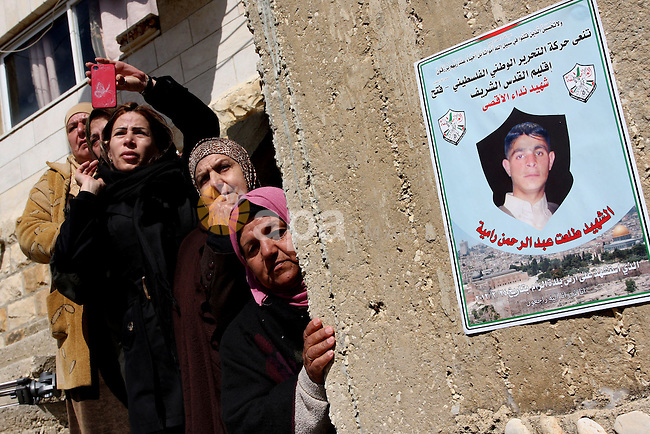 Palestinian women mourn the death of Talaat Rameya during his funeral procession in the town of Al-Ram on the outskirts of Jerusalem on February 25, 2012. Rameya was killed in one of a string of clashes on February 24 between Israeli forces and Palestinian protesters angry over violence in the flashpoint Al-Aqsa mosque compound in Jerusalem's Old City. Photo by Issam Rimawi