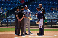Jacksonville Jumbo Shrimp coach Jose Ceballos (30) during the lineup exchange with Alfredo Amezaga (6) and umpires Jose Navas (right), Cody Clark (center), and Sam Burch (left) before a Southern League game against the Mississippi Braves on May 5, 2019 at Trustmark Park in Pearl, Mississippi.  Mississippi defeated Jacksonville 1-0 in ten innings.  (Mike Janes/Four Seam Images)