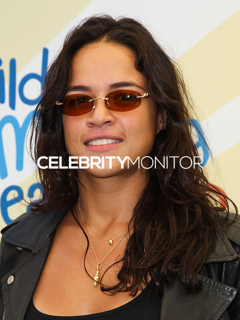 """BEVERLY HILLS, CA, USA - JUNE 14: Michelle Rodriguez at the Children Mending Hearts' 6th Annual Fundraiser """"Empathy Rocks: A Spring Into Summer Bash"""" on June 14, 2014 in Beverly Hills, California, United States. (Photo by Celebrity Monitor)"""